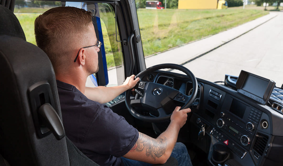 Transport logistics driver at the wheel