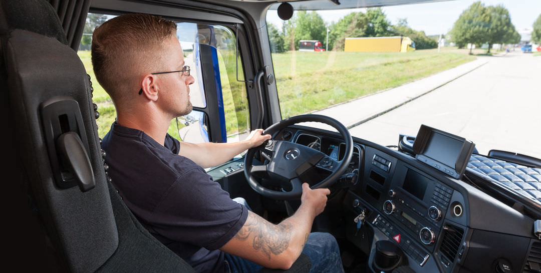 Transport logistics driver at the steering wheel